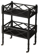 A versatile and unique piece, this mobile server can be used for entertaining or storage purposes. The server features a Black Licorice finish and has two shelves with open fretwork surrounding all sides.. The antique brass casters provide easy mobility. Product Image