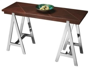 This bold, fashion-forward table features four shimmering stainless-steel, A-shaped legs supporting a large tabletop covered in geometric shapes in stitched leather.