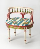 This immaculate vanity seat adds whimsy to any powder or dressing room. Hand crafted from poplar hardwood solids and wood products, it features a carved solid wood back and legs in a boldly colored Alice In Wonderland finish. Product Image