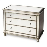 This glamorous console chest features elegant antique mirror inlays on its top, drawer fronts and sides. No detail is overlooked with a beveled edged top and striking pewter finished trim. Handcrafted from select hardwood solids and wood products with ant Product Image