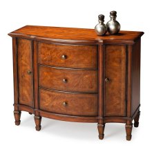 Selected solid woods, wood products and choice veneers. Scored cherry veneer top. Matched cherry and chestnut veneers with inlay on three drawers and two doors. Drawers with dovetail construction are felt lined. Antique brass finished hardware.