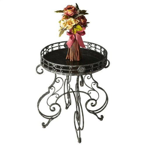 Delightful swirls say magnificence with art nouveau legs that carress an alluring gallery and shimmering black fossil stone inlay tabletop. What an enchanting accent for bedside, chairside or powder room. Old world craftsmanship makes each piece a magni