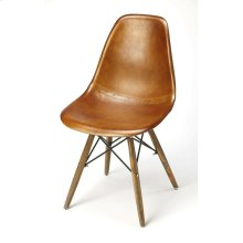 Mid-century modern with a bit of primitive twist; this go-everywhere molded chair form gets an upgrade with the compliment of Warm Brown leather and black metal frame. The soft taper wood legs bring a bit of primitive to the overall style. Set this chair