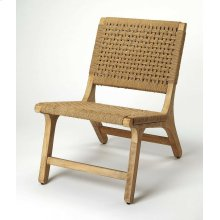 This accent chair will induce a rustic island, yet transitional vibe, with the variation of neutral brown hues all around its surface. The chair has a heightened textural effect with its sturdy jute seating, handwoven by Indian artisans. Its silhouette wi