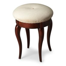 The cabriole legs of this petite vanity stool are made from solid wood and finished in a Plantation Cherry finish. The button-tufted cushioned seat is upholstered in a cotton hobnail fabric. Style 2135024 Vanity Stool pictured is available, but not includ