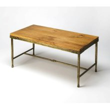 All rustic all the time... and perpetually elegant in its simplicity, this cocktail table is hand-crafted from acacia solid wood and iron. Its pine top and hammered gold tone finish base complement one another perfectly, as it evokes the honesty and spir