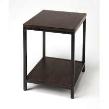 This sleek rectangular end table will add an urban edge to any living space. With a black finished iron frame for a decidely industrial appearance, it features a solid mango wood top and bottom display shelf that are lavishly finished in a dark brown waln