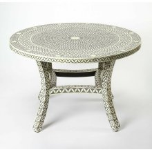 Traditional design with a mix of materials, this distinctive round dining table, sets a tasteful and on-trend foundation in your entertainment ensemble. Founded atop four curved legs, its round tabletop and legs are crafted from Merranti wood, hand cut a