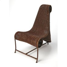 This curvaceous accent chair makes a bold modern statement in any space. Its iron frame is wrapped in woven rattan with rattan solids in a dark rum finish. Featuring bodacious curves from all angles, this chair will draw attention in addition to being a c