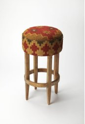 This Southwestern-inspired pouffe bar stool will stylishly enhance your space. Featuring a Mountain Lodge design aesthetic, it is hand crafted from mango wood solids, urethane foam, kilim.