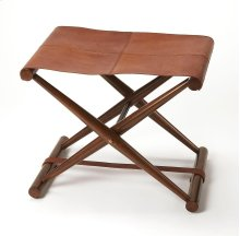 Leather meets wood for a smiple folding seat. Great alone or in multiples; its carefully stitched warm brown leather seat is supported by soild Meranti and Shorea wood base. This stool folds for easy portability and storage.