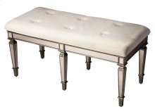 This glamorous bench provides vintage style with its antique-finished mirrored apron and legs and tufted cotton upholstered ivory cushion. It is hand crafted from selected solid woods and wood products in a pewter finish.