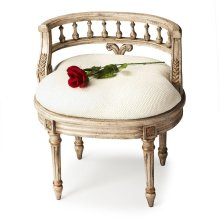 This elegant hand painted vanity seat adds formal elegance to any powder or dressing room. Hand crafted from poplar hardwood solids and wood products, it features a carved solid wood back and legs. The generously-sized, upholstered seat cushion is covered