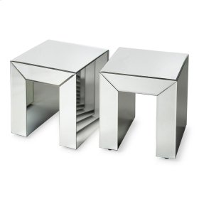 This shimmering bunching table offers an array of design options in virtually any space. Featuring clear mirrored glass veneers over wood products, it can be used in the bedroom as a bedside table or in multiples at the foot of the bed, or in the living r