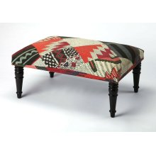 Use this elegantly stylish ottoman as a seat or as a footstool. With its fairly wide surface area, it can also be used as a makeshift coffee table. Its black Mango wood solids legs support a stylish, multi-colored Urethane foam and cotton top.