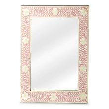 This wall mirror is the prettiest of them all. The delicate floral inlay around all four sides adds blushing beauty with white bone mosaic against a pink background.