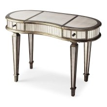 This glamourous and curvy vanity with mirrored top, front and sides and complementary pewter trim, square tapered legs, makes a strong style statement while providing abundant storage. It offers two drawers, plus a storage compartment beneath the hinged c