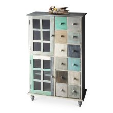 This stunning accent chest is handcrafted from mango hardwood solids and wood products and hand finished in a whimsical profusion of pastels. It features abundant storage with two top drawers and compartments behind four doors on the bottom right and left
