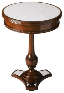 The carved mahogany of this round table gains beauty when paired with the mirrored top and base. The functionality of this table is enhanced by the original simplistic beauty created by the antiqued mirrors and wood.
