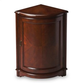 Selected solid woods, wood products and choice veneers. Cherry veneer top, matched cherry veneer door panel. Interior shelf behind door. Antique brass finished hardware.
