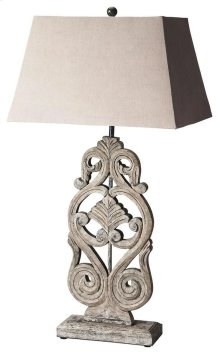 This distinctive table lamp will brilliantly light any space. Featuring a cathedral gray finish, it is hand crafted from mango wood solids with an iron harp and cotton shade.