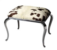 This ottoman has a definite flair for the dramatic. Crafted from cast aluminum and wood products, it features a genuine cowhide seat. Completing the look are classically styled cabriole legs in a nickel plated finish for just the right touch of bling. Not