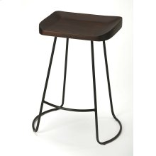 The intriguing lines of the black wrought-iron base provide the perfect complement to the distressed dark brown finish on the sculpted solid mango wood seat, ensuring this Bar Stool is as stylish as it is practical.