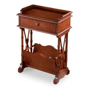 Ample storage and display space in this simply elegant Martini Table that combines function and aesthetics without sacrificing either. Handcrafted from hardwood solids, wood products and cherry veneers in a rich Plantation Cherry finish. Single drawer wit