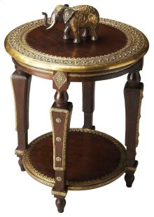 Meticulously crafted from exotic mango wood solids with a hand-applied brass foil top, this elegant table showcases old world flair with an international mystery. Metculous hand crafted detail on legs, top and shelf make this a truly one-of-a kind piece.
