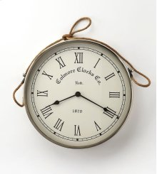 This wall clock is crafted in a round chrome tone frame that features Roman numerals over a white face, and a nautical twine handle. The clock can be placed on any wall and blends with a variety of decor. Makes a great gift.