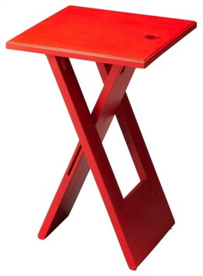 This versatile folding table is essential for its portable function and clean modern design. Crafted from mango wood solids, it features a whimsical painted red finish.