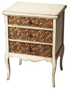 This carved wood chest brings gilded glamour to your home. The antique white finish on gemelina wood solids and wood products is lightly distressed, but the focal point is its antique gold appliques on the drawer fronts. Featuring three felt-lined drawers