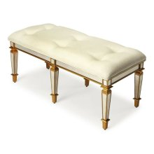 This glamorous bench provides vintage style with its antique-finished mirrored apron and legs and tufted cotton upholstered ivory cushion. It is hand crafted from selected solid woods and wood products in a stunning gold finish.