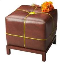 This versatile leather ottoman with a button-tufted cushioned top functions as a stand alone piece or can be used in multiples in front of a sofa. The contrasting welt sets it apart from most other ottomans. The frame is made of select hardwoods.