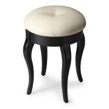 The cabriole legs of this petite vanity stool are crafted from solid wood and birch veneers with a sleek in Black Licorice finish. Features a button-tufted cushioned seat upholstered in a cotton hobnail fabric.
