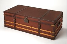 Beautiful large canvas clad storage trunk with leather banding makes storage useful and decorative. Perfect for living spaces to store blankets, games, and more and may even be used as a small storage coffee table. Flat-topped lid with and nail head trim