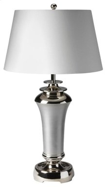 This modern table lamp will brilliantly light any space. Featuring a nickel finish, it is hand crafted from aluminum with an iron harp and cotton shade.