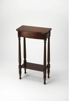 A graceful bright spot for a small space, the hallmark of this Console Table's exquisite design is the prominence of four slender legs - carved and turned and immaculately shaped. The petite tabletop and apron shimmer in traditional Plantation Cherry fini