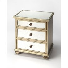 This glamourous chest with mirrored top and front and complementary silver tone trim, makes a strong style statement while providing abundant storage. It offers three drawers. Hardware is finished in sophisticated antique brass. Crafted from hardwood soli