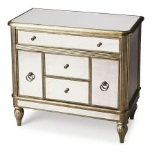 Classic lines and ballerina feet paired with antique mirror inlays give this elegantly understated console cabinet a glitzy vibe. Crafted from select hardwood solids and wood products, it features pewter finished trim and antique mirror inlays on the top,