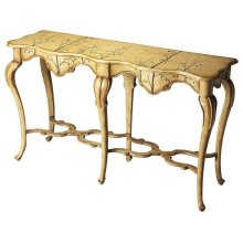This console table offers a bold aesthetic with long, stylized cabriole legs, an elaborately carved apron, serpentine stretchers and tabletop, and whimsical linen-crackled hand-painted Winter Forest finish. It is expertly crafted from poplar hardwood soli