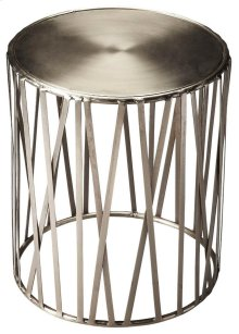 Pound out some serious style on the Kruse iron drum table. The round polished top is poised over open ironwork ribs. The silver metal finish gives this already modern piece even more of a contemporary air.
