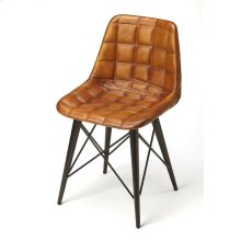 Mid-century modern with a symetrical leather pattern; this go-everywhere molded chair form gets an upgrade with the compliment of Warm Brown quilted leather and black metal frame. The soft taper metal legs bring a bit of retro modern to the overall styl