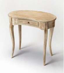 This elegant Writing Desk features a crescent shape tabletop supported by four stylized, tapered cabriole legs and a drawer with antique brass-finished hardware. It is crafted from solid poplar and cherry veneer in a calming Driftwood finish.