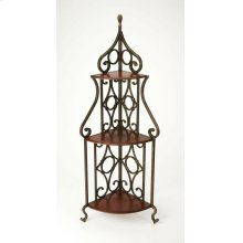This one-of-a-kind baker's rack has a charm all its own. Ruggedly constructed, its forged decorative pewter metal frame and fruitwood finished wood shelves give it a distinctive appearance. The corner design of this baker's rack also gives it versatility