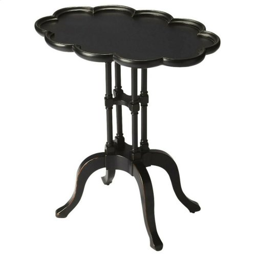 This scalloped oval accent table will blend beautifully with any home décor. Crafted from selected wood solids and choice veneers, featuring a Black Licorice finish and scalloped pie crust-shaped framed top this accent table is a unique piece that showcas