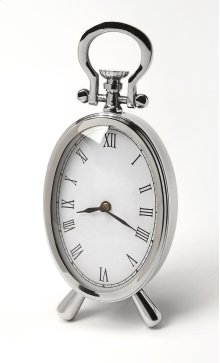 This desk clock is crafted in an oval shape that features Roman numerals over a white face, featuring a kick stand and a sturdy handle. The clock can be placed on any table or shelves , blends with a variety of decor. Makes a great gift.