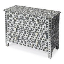 Sophisticated artistry and craftsmanship go into the detailed botanic and geometirc pattern on the drawers, top and sides of this delightful chest. White bone inlays individually cut and applied against a black background make each dresser a bonafide ori