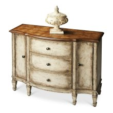 Offering abundant storage behind two doors and inside three dovetailed drawers, this spacious console cabinet is crafted from poplar hardwood solids and wood products with a beautiful ash burl veneer top. The Toasted Marshmallow finish gives it an antique