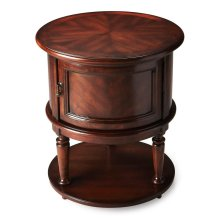 This dark, Plantation Cherry finished Coffield drum table offers ample storage. The beautiful cherry veneer compliments the round top and second shelf below the storage.